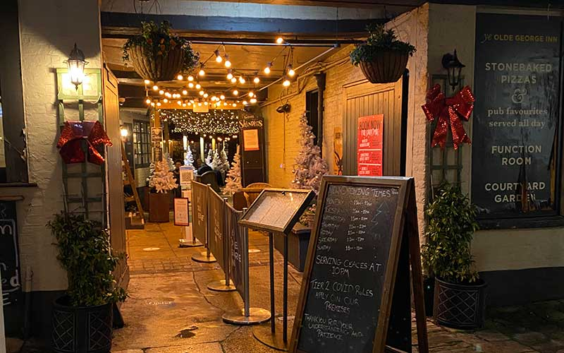 Ye Olde George Inn archway at night
